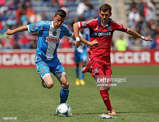 Sebastien Le Toux of the Philadelphia Union holds off Gonzalo Segares of Chicago Fire during an MLS match at Toyota Park on May 11 2013 in Bridgeview...