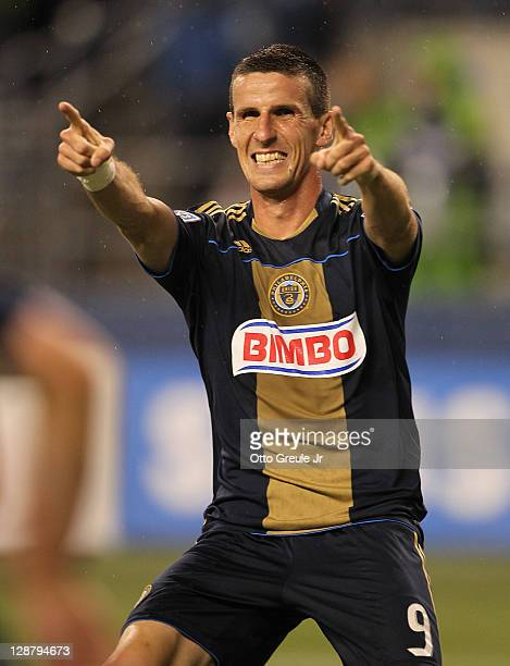 Sebastien Le Toux of the Philadelphia Union points to teammate Brian Carroll after Carroll scored a goal against the Seattle Sounders FC at...