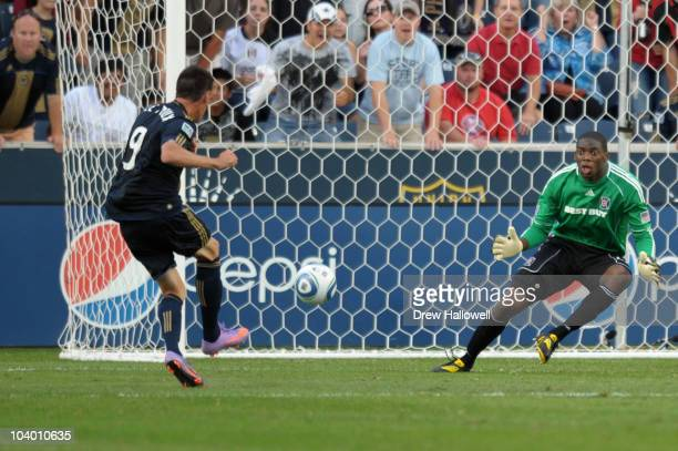 Sebastien Le Toux of the Philadelphia Union shoots and scores on goalkeeper Sean Johnson of the Chicago Fire at PPL Park on September 11 2010 in...