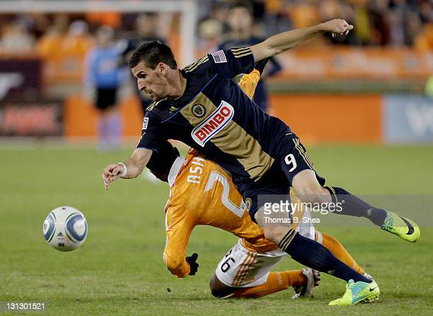 Sebastien Le Toux of the Philadelphia Union wins the ball against Corey Ashe of the Houston Dynamo in the second leg of the playoffs on November 3...