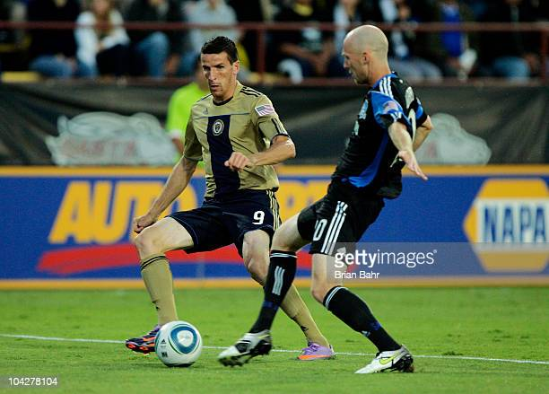 Sebastien Le Toux of the Philadephia Union ties to center the ball past Tim Ward of the San Jose Earthquakes on September 15 2010 at Buck Shaw...