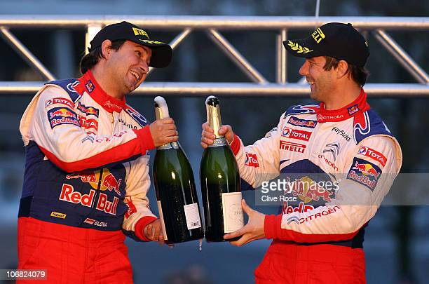 Sebastien Loeb and Daniel Elena of France celebrate winning the Wales Rally of GB on top of the Citroen Total C4 after stage three of the Wales Rally...