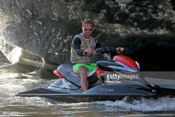 Sebastien Loeb is seen on his jet ski in the port on July 26 2014 in SaintTropez France