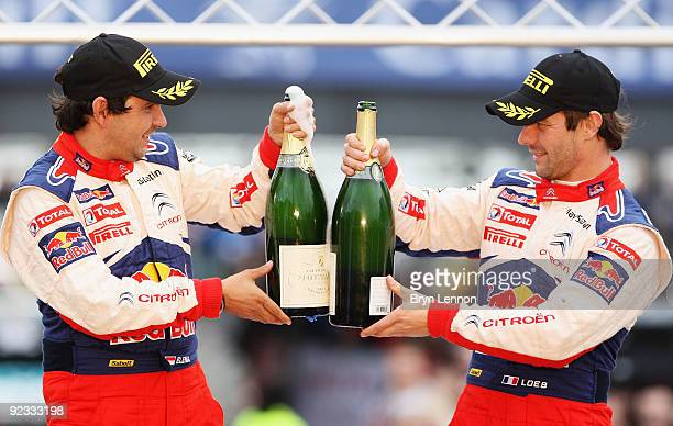 Sebastien Loeb of France and Citroen and codriver Daniel Elena celebrate winning the World Rally Championship at the 2009 Wales Rally GB on October...