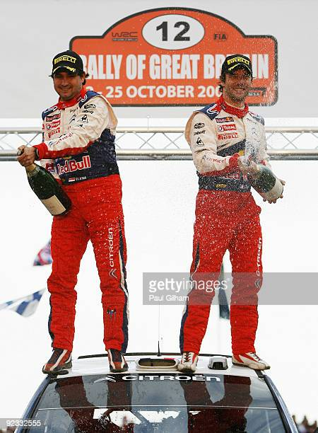 Sebastien Loeb of France and Citroen Total WRT and his co-driver Daniel Elena celebrate on their Citroen C4 WRC after winning the World Championship...