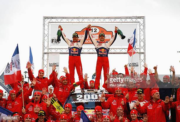 Sebastien Loeb of France and Citroen Total WRT and his codriver Daniel Elena celebrate on the Citroen C4 WRC alongside the Citroen Total WRT Team...
