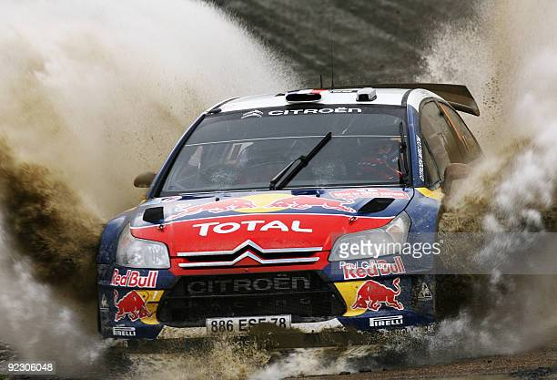 Sebastien Loeb of France and Citroen Total WRT drives the Citroen C4 WRC during stage two of the Wales Rally GB at Sweet Lamb on October 23, 2009 in...