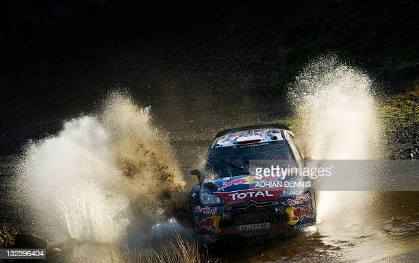 Sebastien Loeb of France and codriver Daniel Elena drives his Citroen DS3 through a water splash on the Sweet Lamb stage during the third day of the...