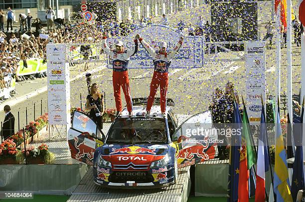 Sebastien Loeb of France and Daniel Elena of Monaco celebrate their 7th WRC Title in front of the European Parliament during Leg 3 of the WRC Rally...