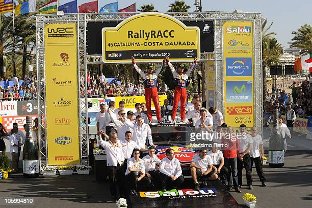 Sebastien Loeb of France and Daniel Elena of Monaco celebrate their victory together the Citroen World Rally Team in the final podium of the WRC...