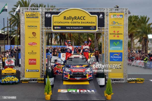 Sebastien Loeb of France and Daniel Elena of Monaco celebrate their victory on day 3 of the WRC Rally of Spain on October 23 2011 in Salou Spain