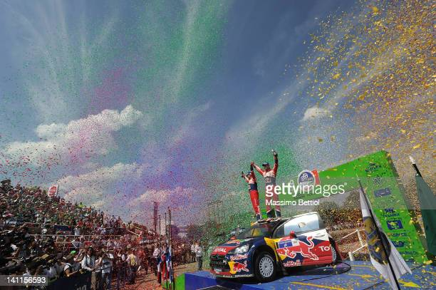 Sebastien Loeb of France and Daniel Elena of Monaco celebrate their victory during day three of the WRC Rally Mexico on March 11 2012 in Leon Mexico