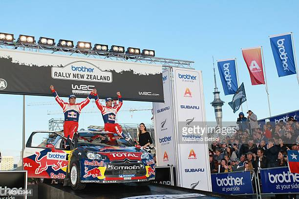 Sebastien Loeb of France and Daniel Elena of Monaco celebrate their success during Day Three of the WRC Rally New Zealand on June 24 2012 in Auckland...