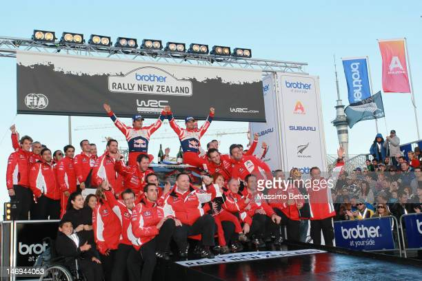 Sebastien Loeb of France and Daniel Elena of Monaco celebrate their success with the complete Citroen Total World Rally Team during Day Three of the...