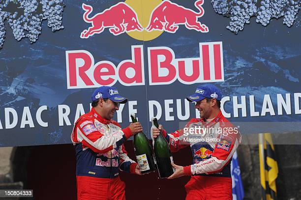 Sebastien Loeb of France and Daniel Elena of Monaco celebrate their victory during Day 3 of the WRC Rally Germany on August 26 2012 in Trier Germany