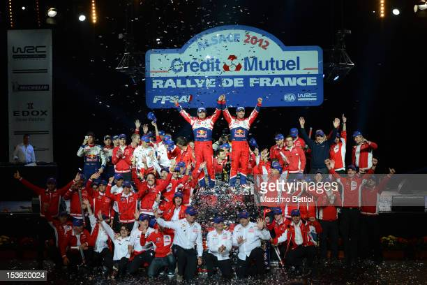 Sebastien Loeb of France and Daniel Elena of Monaco celebrate their nine WRC title with all the Citroen Total WRT members during Day Three of the WRC...