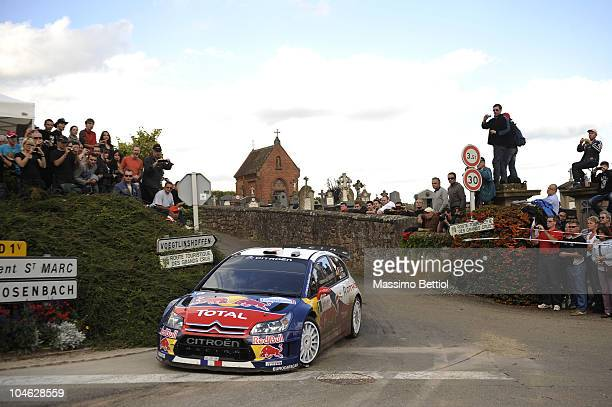 Sebastien Loeb of France and Daniel Elena of Monaco compete in their Citroen C4 Total during Leg 1 of the WRC Rally of France on October 1 2010 in...