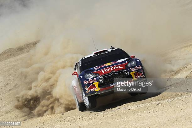 Sebastien Loeb of France and Daniel Elena of Monaco compete in their Citroen Total WRT Citroen DS3 WRC during Day 1 of the WRC Rally Jordan on April...