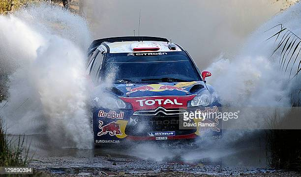 Sebastien Loeb of France and Daniel Elena of Monaco compete in their Citroen Total WRT Citroen DS3 WRC during the second stage of the first day of...