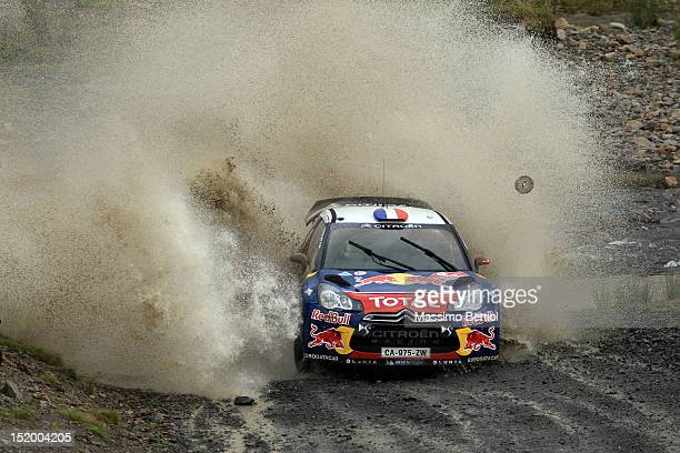 Sebastien Loeb of France and Daniel Elena of Monaco compete in their Citroen Total WRT Citroen DS3 WRC during Day One of the WRC Wales Rally GB on...