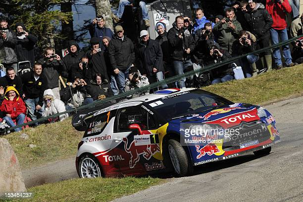 Sebastien Loeb of France and Daniel Elena of Monaco compete in their Citroen Total WRT Citroen DS3 WRC during Day One of the WRC Rally of France on...