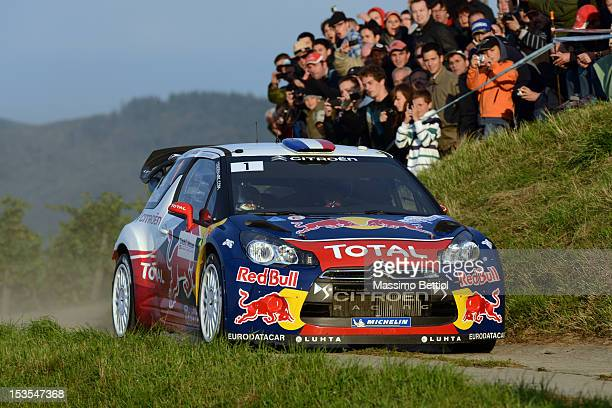 Sebastien Loeb of France and Daniel Elena of Monaco compete in their Citroen Total WRT Citroen DS3 WRC during Day Two of the WRC France on October 06...