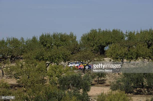 Sebastien Loeb of France and Daniel Elena of Monaco compete in their Citroen C 4 Total during Leg 3 of the WRC Rally de Espana on October 04 in Salou...