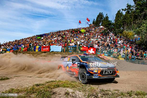 Sebastien Loeb of France and Daniel Elena of Monaco compete with their Hyundai Shell Mobis World Rally Team Hyundai I20 Coupe WRC during the Special...