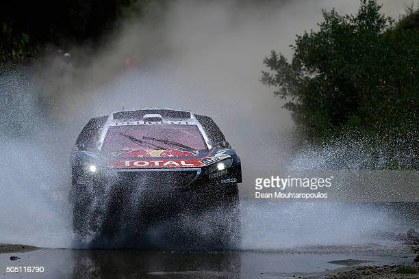 Sebastien Loeb of France and Daniel Elena of Monaco in the PEUGEOT 2008 DKR for TEAM PEUGEOT TOTAL compete on day 13 / stage twelve between San Juan...