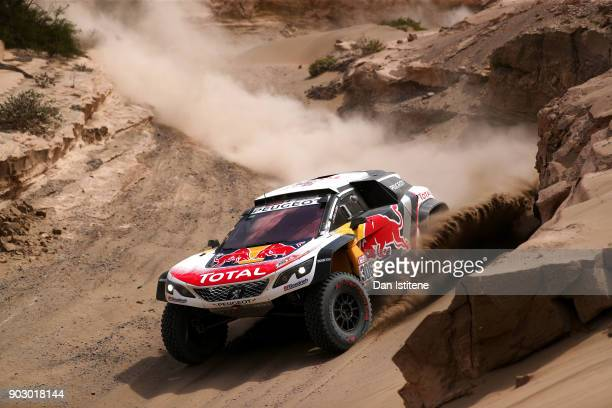 Sebastien Loeb of France and Peugeot Total drives with codriver Daniel Elena of Monaco in the 3008 DKR Peugeot car in the Classe T14 2 Roues Motrices...