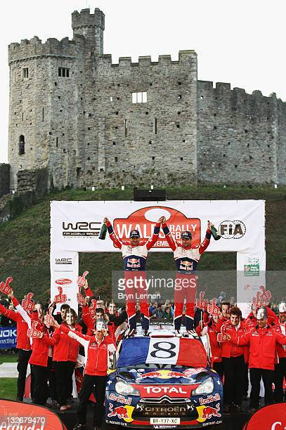 Sebastien Loeb of France and the Citroen Total World Rally Team celebrates with codriver Daniel Elena of Monaco after winning an eighth World...
