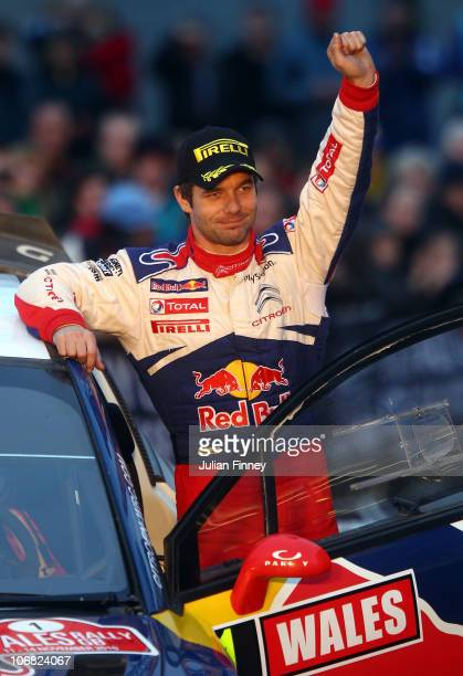 Sebastien Loeb of France celebrates winning the overall 2010 championship after stage three of the Wales Rally GB at Cardiff Bay on November 14 2010...