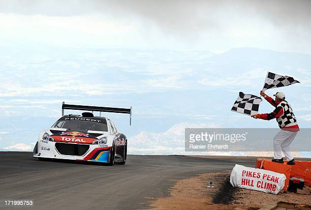 Sebastien Loeb of France driver of the Peugeot 208 T16 Pikes Peak crosses the finish line setting a record time of 813878 during the Pikes Peak...