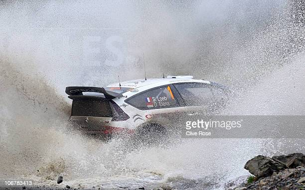 Sebastien Loeb of France drives the Total Citroen C4 during the Sweet Lamb stage of the Wales Rally GB on November 12 2010 in Llangurig Wales