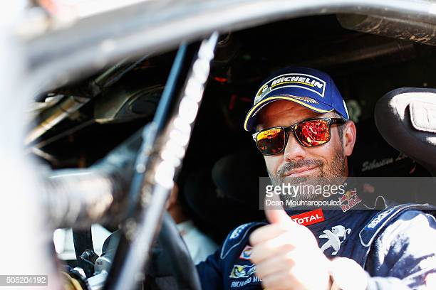 Sebastien Loeb of France in the PEUGEOT 2008 DKR for TEAM PEUGEOT TOTAL arrives at the end of stage thirteen between Villa Carlos Paz and Rosario on...