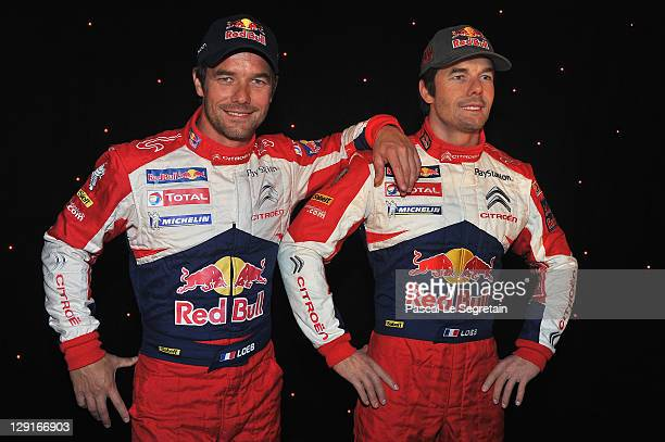Sebastien Loeb poses next to his wax figure at Musee Grevin on October 13, 2011 in Paris, France.
