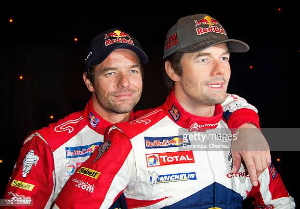 Sebastien Loeb poses next to his wax figure at Musee Grevin on October 13 2011 in Paris France