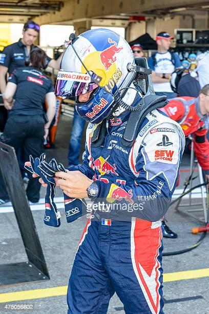 Sebastien Loeb racing driver in the pit lane
