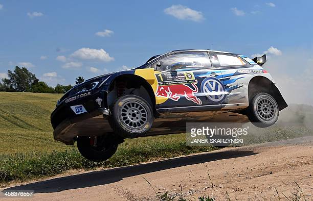 Sebastien Ogier and codriver Julien Ingrassia of France drive their Volkswagen Polo R WRC during the special stage at the Rally Poland in Babki...