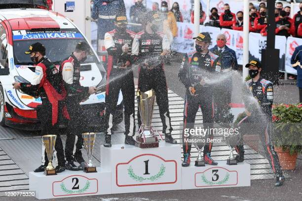 Sebastien Ogier and Julien Ingrassia of France celebrate on the podium during day four of the FIA World Rally Championship Monte Carlo on January 24,...