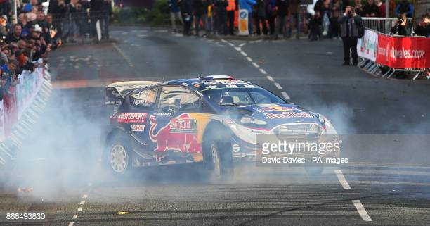 Sebastien Ogier celebrates winning the World Championship with a doughnut in the MSport WRT Ford Fiesta WRC during day four of the Dayinsure Wales...