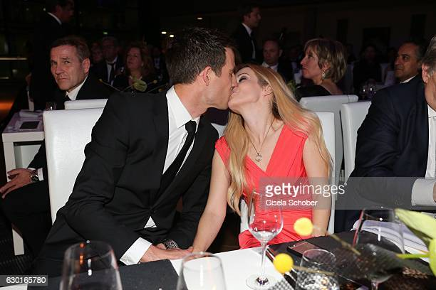 Sebastien Ogier fourtimes and current Rallye World Champion and his wife Andrea Kaiser during the ADAC sportgala 'Die Nacht der Sieger 2016' on...