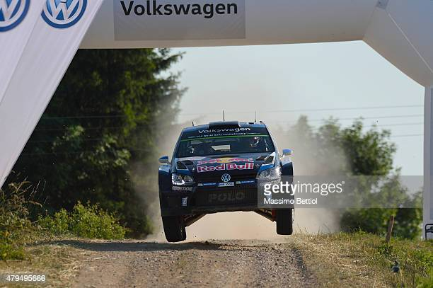 Sebastien Ogier of France and Julien Igrassia of France compete in their Volkswagen Motorsport Volkswagen Polo R WRC during Day Two of the WRC Poland...