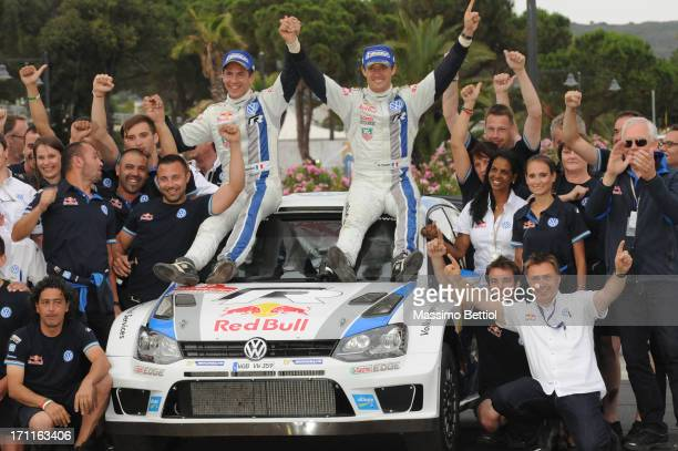 Sebastien Ogier of France and Julien Ingrassia of France celebrate their victory during Day Two of the WRC Italy on June 22 2013 in Olbia Italy