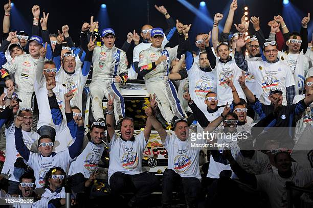 Sebastien Ogier of France and Julien Ingrassia of France celebrate their World Rally Title with all the Volkswagen Motorsport staff members on the...