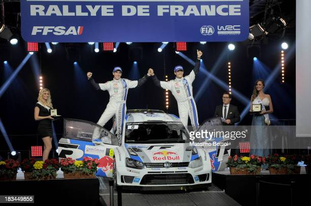 Sebastien Ogier of France and Julien Ingrassia of France celebrate their World Rally Championship Title in the final podium during Day Three of the...