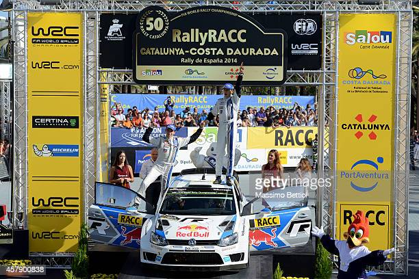 Sebastien Ogier of France and Julien Ingrassia of France celebrate their Worl Rally Champion title on the final podium during Day Three of the WRC...