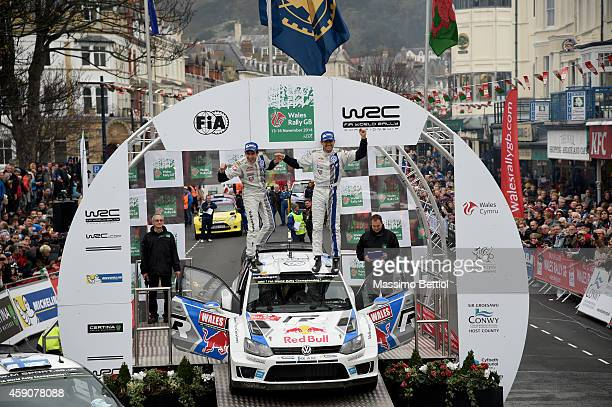 Sebastien Ogier of France and Julien Ingrassia of France celebrate their victory in the final podium during Day Three of the WRC Great Britain on...
