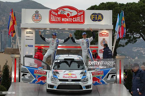 Sebastien Ogier of France and Julien Ingrassia of France celebrate their victory in the final podium during Day Four of the WRC MonteCarlo on January...