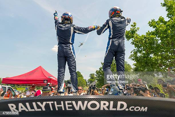 Sebastien Ogier of France and Julien Ingrassia of France celebrate their victory during Day Three of the WRC Poland on July 5 2015 in Mikolajki Poland